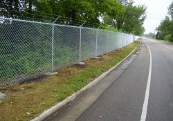 Security Fence Along Louisiana-Lake Drive / Looking West (August 8, 2014)