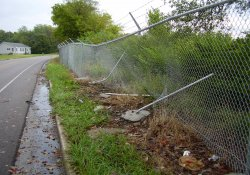 Security Fence Damage From a Traffic Collision on Lake Drive / Looking East (October 2, 2014)