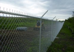 Security Fence Along Lake Drive, Western Boundary of OU-1 / Looking South (July 1, 2014)