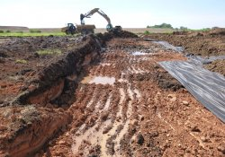 Material Removal from OU-2 Former Ballfields Area to OU-1 Area 1A / Looking East / Southeast (July 14, 2015)