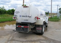 Water Truck Cleaning OU-2 Entrance Road / Looking East (June 26, 2015)