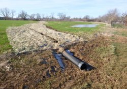 Drainage Pipe, 3102 Louisiana Blvd / Looking West (January 5, 2016)