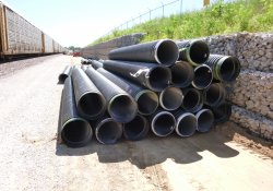 A&S Railroad Gabion Wall Drainage Pipe Staged Along Eastern OU-1 Boundary / Looking South (July 31, 2015)