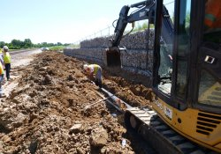 Installation of A&S Railroad Gabion Wall Drainage Pipe Along Eastern OU-1 Boundary / Looking South (July 31, 2015)