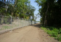 Security Fence, Southeast Corner of Site / Looking West / Southwest (July 31, 2014)