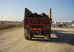 Used Tires Being Transported Off-Site / Looking South (November 20, 2014)