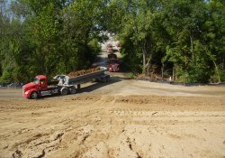 Clean Soil Cover Haul Trucks Entering OU-1 / Looking South (August 26, 2014)
