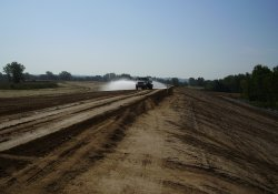 Water Truck Wetting Down Clean Soil Cover Haul Road / Looking East (August 26, 2014)